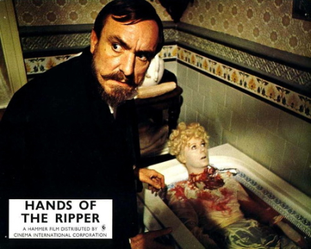 Hands of the ripper maid in a bathtub